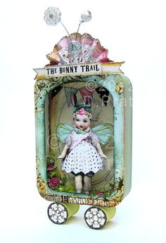 bunny trail altered tin by D.Pratt The post bunny trail altered tin by D.Pratt appeared first on Wer Tin Can Crafts, Diy And Crafts, Paper Crafts, Arts And Crafts, Handmade Crafts, Handmade Rugs, Altered Tins, Altered Art, Paper Dolls