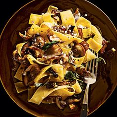 Pappardelle with Mushrooms Recipe Main Dishes with dried porcini mushrooms, boiling water, pappardelle pasta, salt, olive oil, shallots, mushrooms, garlic cloves, dry sherry, parmigiano reggiano cheese, heavy whipping cream, chopped fresh sage, cracked black pepper, truffle oil, sage leaves