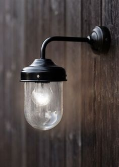 Black Barn Lamp is a stylish, durable outdoor garden wall light, ideal for a porch, garage or shed.