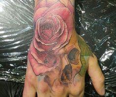 Skull & rose hand tattoo