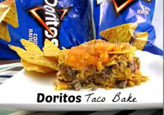 Make dinner in a snap with this crafty casserole recipe. Inspired by one of your favorite grocery store recipes, everyone will thank you when you cook up this Just Like A Doritos Taco Bake. It features layers of ground beef or turkey, Doritos and tac Doritos Taco Bake Recipe, Dorito Taco Bake, Doritos Casserole, Casserole Dishes, Beef Dishes, Food Dishes, Main Dishes, Tex Mex, Mexican Dishes