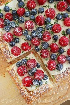 Summer Berry Tart. Puff pastry with a little dab of Cool Whip, fresh berries, a little dab of mint and a WHOLE lot of hungry tastebuds!