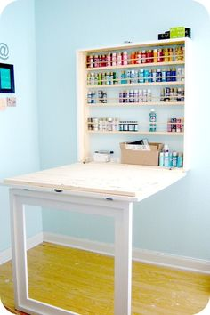 Built-In Craft Table: Folds up into a frame on the wall when not in use and then folds down to reveal a workstation