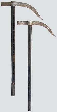 Ottoman war hammers (kulunk), 19th century, front hammer and strongly curved rear pick with remnants of floral silver inlay, wooden shafts with an iron grip sleeve. Length 47.5 and 50 cm.