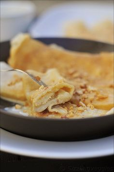 Eggless Crepes filled with coconut and condensed milk....Bengali delicacy that's so delicious.
