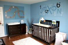 The blue-on-blue #wallart is so fun in this #nursery.  #blue #nameart