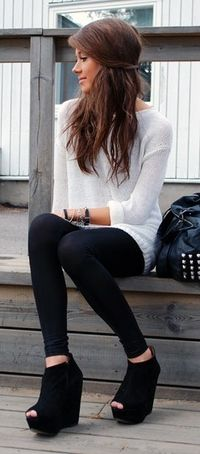 White jersey, black tights, black peep-toe wedge boots                                                                                                                                                      More