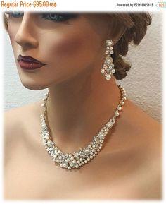 A personal favorite from my Etsy shop https://www.etsy.com/listing/233184438/bridal-gold-jewlery-bridal-back-drop-bib