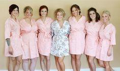 Bridesmaid in blush pink robes.