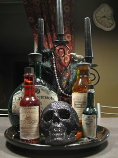 Halloween bottles and potions...this gives me an idea...Put them on a pedestal cake stand!