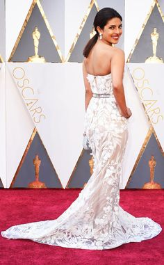 Priyanka Chopra stunned on the red carpet. Click to see more best dressed looks, presented by @dietcokeus.
