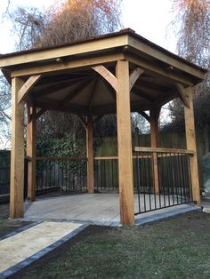 Solid Oak Frame Band Stand style Gazebo with Cedar Shingle roof and Oak banister topped side rails. Oak Banister, Banisters, Gazebo, Pergola, Oak Framed Buildings, Solid Oak, Outdoor Structures, Band, Style