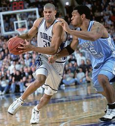 Julius Peppers defends Shane Battier in a 2001 Tar Heel win (SI photo)