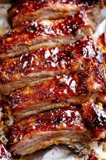 Sticky Oven Barbecue Ribs Oven Barbecue Ribs slathered in the most delicious sticky barbecue sauce with a kick of garlic and optional heat! Juicy melt-in-your-mouth oven baked Barbecue Ribs are fall-off-the-bone delicious! Double up on incredible flavour Babyback Ribs In Oven, Oven Pork Ribs, Ribs Recipe Oven, Baked Bbq Ribs, Barbecue Pork Ribs, Beef Ribs, Barbecue Sauce, Bbq Sauces, Pork Rib Recipes