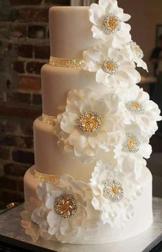 WWW.DECORATEMYWEDDING.COM  Sparkling Cake Decor -Rhinestone Banding & Cake Brooch Decorations.  Sensational Sparkle.  Available in silver and gold.