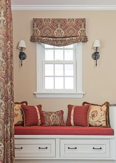 Custom window treatments, pillows and window seat cushion.