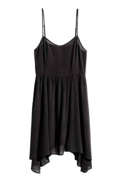 Crêpe dress: Short dress in viscose crêpe with narrow adjustable shoulder straps, smocking at the back, a seam at the waist and wide skirt. Unlined.