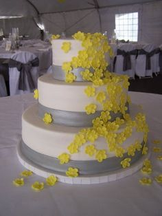 Yellow and silver three tiered wedding cake