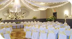 cover chairs with color ribbon around it for hall
