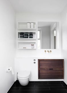 small bathroom solutions Storage shelves above toilet, ledge above toilet, large draws, gold plumbing, add storage behind mirror - YES! Bathroom Toilets, Laundry In Bathroom, Bathroom Shelves, Small Bathroom, Light Bathroom, Guest Bathrooms, Bathroom Layout, Minimalist Bathroom, Minimalist Kitchen