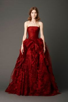 Vera Wang | Crimson strapless ballgown with hand-draped tulle bodice and honeycomb tulle skirt with embellished floating Chantilly lace and bias-cutorganza ruffle detail