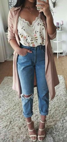 Romantic date night outfit, cute floral top with ripped blue jeans and beige coat with sandal heels.