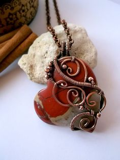 Copper wire wrapped heart pendant -  The pendant is made in a lovely wire wrapping jewelry technique made of copper and jasper. The metal has been hammered, patinated, polished and lacquered by a special varnish.