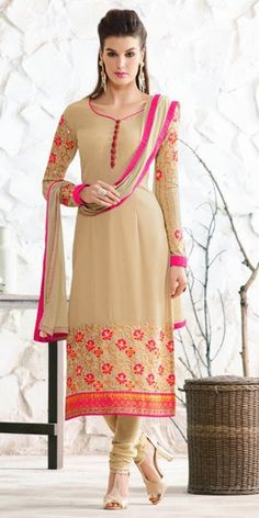 Fabulous Cream And Orange Georgette Straight Suit.