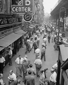 Busy streets: Men and women stroll a row of jewelry shops on the Lower East Side (right) and stand in line for bread during the Great Depression (left)