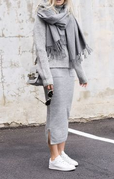 Combining various shades of grey is always a good idea. Figtny wears a slitted grey midi skirt with a cute grey knitted sweater and a matching scarf. Both ideal for the winter cold and effortlessly stylish, this look is a winner!Brands Not Specified.