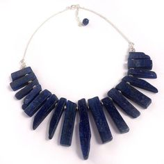 Zaffre Statement Nec  Zaffre Statement Nec  Zaffre Statement Necklace Zaffre is a stunning bright and bold lapis lazuli Statement Necklace that has been lovingly handcrafted in our studio as part of our Statement Rock jewellery range. Bold yet graceful, the Zaffre necklace features smooth and radiant genuine lapis lazuli gemstones and is finished off with a quality silver plated chain and lobster clasp.