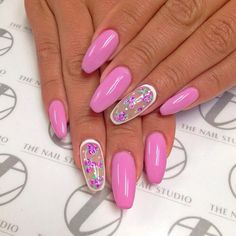 Barbie pink acrylic nails with floral design