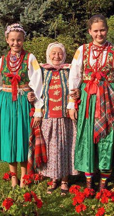 folk costumes of poland - this granny is showing off her girls - (photo creative commons wikipedia)