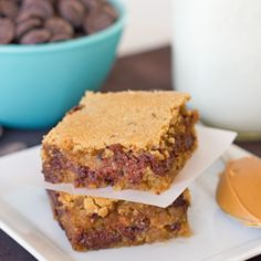 Peanut Butter Chocolate Chip Bars just begging for you to be naughty and slice into them warm from the oven.