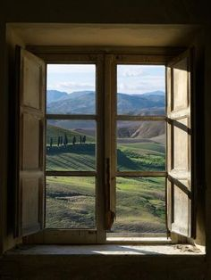 Outside View of Cypress Trees and Green Hills Through a Shabby Windows Photographic Print by ollirg at Art.com
