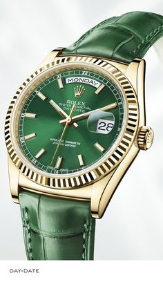 Rolex Day-Date 36 mm in yellow gold, fluted bezel, green dial and leather strap. #RolexOfficial