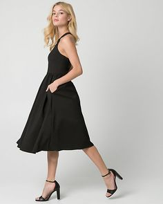 Satin Halter Cocktail Dress - A perfectly pleated satin dress will add a whimsical touch to your evening look.