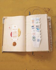 Tabs -- made from book-binding tape that was rubber-stamped, cut into two-inch strips, folded in half, and glued to the paper -- mark each page with a little character.