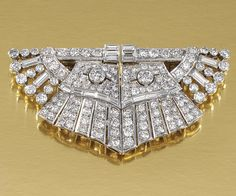 DIAMOND DOUBLE CLIP BROOCH, 1930S. Of odeonesque design, set with circular-, single-cut and baguette diamonds, French assay marks, please note that this jewel can be worn in two combinations as a double clip, as well as a pair of single clip.