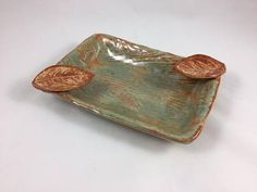 Ceramic Cigar Ashtray, Rectangular Ashtray, Cigar Ashtray, Rustic Ashtray This Cigar Ashtray is made of Stoneware Clay and High Fire Glaze This cigar tray is for the cigar lover. My husband loves an occasional cigar and most ashtrays can be unattractive. This ashtray makes for a