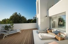 """The """"garden"""" terrace, completely decked and equipped with sun loungers, parasols and lounge matrasses to enjoy the glorious weather the Algarve has to offer. It also has an outside shower to refresh yourself while sunbathing"""