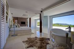 Just when you thought your villa in Ibiza couldn't get any better, you step foot into the master suite and it's love at first sight. Jaw-dropping views, an open-plan ensuite bathroom and the plushest bed you've ever seen - more than just a bedroom, this is heaven on earth...