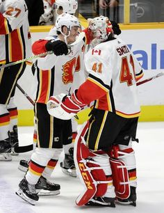 Calgary Flames left wing Matthew Tkachuk, left, celebrates with goalie Mike Smith (41) after Tkachuk scored the winning goal against the Nashville Predators during a shootout in an NHL hockey game Tuesday, Oct. 24, 2017, in Nashville, Tenn. Calgary won 3-2. (AP Photo/Mark Humphrey)