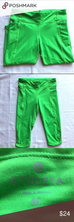 "Athleta neon green compression fitness Capri M Athleta compression neon green athletic fitness pants sz M.  Reflective strips, back zipper pocket, hip pockets.  Great for nighttime runs.  Approximate flat lay measurements: waist/hip 15"", rise 9"", inseam 18"". Athleta Pants Track Pants & Joggers"