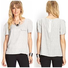 "HPForever21 Silky Bubble Top Forever21 Silky Bubble Top Zip Closure on the back Chest ""Pocket"" just an illusion not an actual pocket Colors: Black& White which makes it look grey through the design Measurements: 22 inches from Top ⬇️ Bottom 18 inches from Left ➡️ Right Armpit to Armpit 6 inches sleeve from Top ⬇️ Bottom (Just sleeve not shoulder from sleeve) (Top of the sleeve to bottom) 100% Polyester ❗️ Found 1 hole/ Rip under 1 armpit ❗️ ❗️Price is FIRM❗️ ❌No Trades❌ Forever 21 Tops…"
