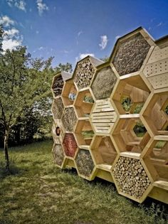K-abeilles Hotel for Bees // atelierd.org // Muttersholtz, France. A hotel for bees, the outside faces of the structure are hexagonal compartments providing a variety of nesting materials. These small shelters provide habitat for endangered wild bees, while the interior provides seating and a covered area for people.