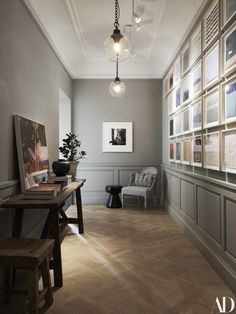 The Nordroom - Grey Hallway with Gallery wall in a Stockholm Family Home Designed by Ilse Crawford Architectural Digest, H Design, House Design, Casa Milano, Grey Hallway, Hallway Inspiration, Hall Lighting, House Entrance, Grey Walls