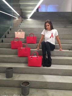 Bag lady: Victoria posed on the steps to her store with a series of envy-inducing arm cand... ♦ℬїт¢ℌαℓї¢їøυ﹩♦