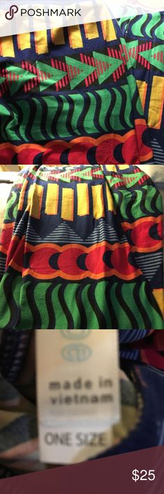 LulaRoe Leggings OS Brand New LulaRoe Leggings, Size is OS and fits sizes 0-10.  Background color is Navy Blue with a geometric design with colors of yellow, green, red & orange. Made in Vietnam LuLaRoe Other