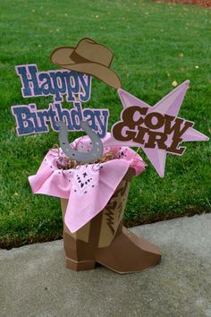 This Cowgirl centerpiece is perfect for your cowgirl themed birthday party! Its approx 2 ft. tall. The 3D cowboy boot is constructed out of card